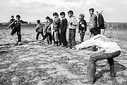 A group of children is playing soccer. <br /> <br /> During the Winter 2015/16 more than 15`000 refugees tried the travel to West Europe, but were stopped by closed borders. They set up a provisional camp close to the small village of Idomeni in northern Greece.