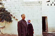 one kurdish couple poses in their own courtyard in the old town of Sanliurfa