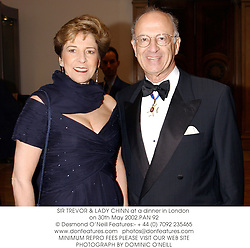 SIR TREVOR & LADY CHINN at a dinner in London on 30th May 2002.	PAN 92