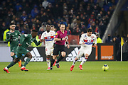 Houssem Aouar of Lyon and Tanguy Ndombele of Lyon and Ruddy Buquet referee during the French Championship Ligue 1 football match between Olympique Lyonnais and AS Saint-Etienne on february 25, 2018 at Groupama stadium in Décines-Charpieu near Lyon, France - Photo Romain Biard / Isports / ProSportsImages / DPPI
