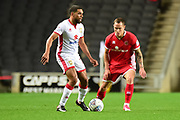 Milton Keynes Dons defender (on loan from Bristol City) Scott Golbourne (12) looks to release the ball under pressure from Walsall midfielder Kieron Morris (11) during the EFL Sky Bet League 1 match between Milton Keynes Dons and Walsall at stadium:mk, Milton Keynes, England on 17 October 2017. Photo by Dennis Goodwin.