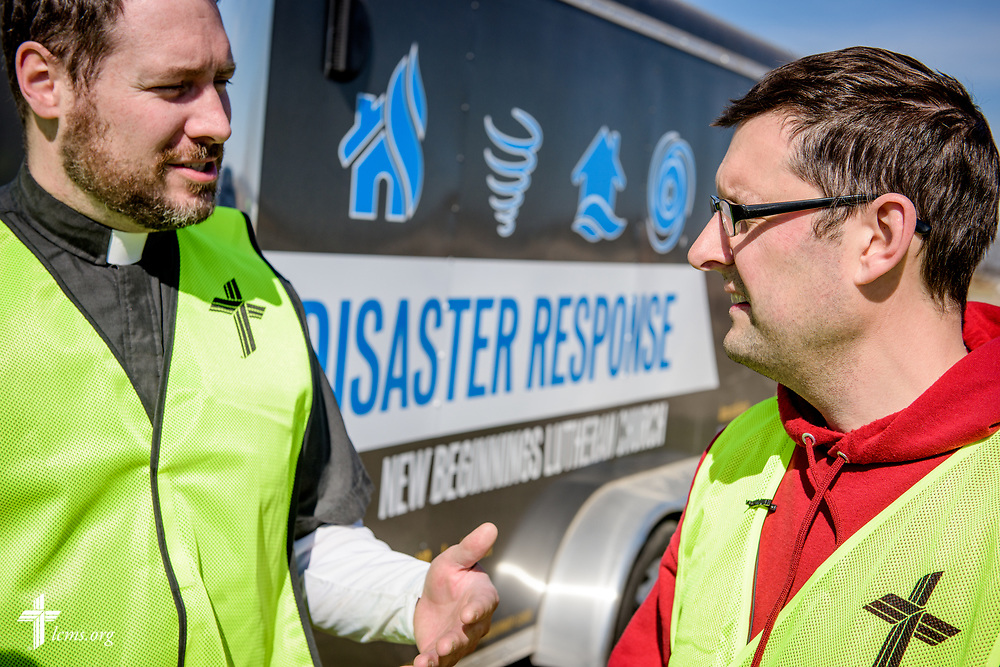The Rev. Michael Meyer, manager of LCMS Disaster Response, talks to Travis Torblaa, mission and ministry director at New Beginnings Lutheran Church, Pacific, Mo., outside a destroyed home on Saturday, March 4, 2017, in Perryville, Mo. LCMS Communications/Erik M. Lunsford