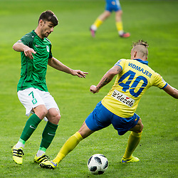 Rok Kronaveter of NK Olimpija Ljubljana and Tadej Vidmajer of NK Celje during football match between NK Olimpija Ljubljana and NK Celje in 1st leg match in Semifinal of Slovenian cup 2017/2018, on April 4, 2018 in SRC Stozice, Ljubljana, Slovenia. Photo by Urban Urbanc / Sportida