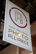 """Outdoor signage with logo; Sylvia Plachy walks and talks about the """"Forever Hold Your Peace"""" exhibit at the New Orleans Photo Alliance gallery"""