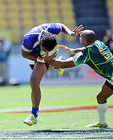 Samoa's Alatasi Tupou tackled by South Africa's Cornal Hendricks at the IRB International Rugby Sevens, Westpac, Wellington, New Zealand, Friday, February 01, 2013. Credit:SNPA / Ross Setford