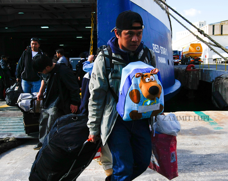 Filipino evacuees from Misurata in Libya disembark from the ferry MV Red Star One after arriving at Valletta's Grand Harbour March 6, 2011.  The Indian-chartered ferry arrived in Malta on Sunday morning carrying 301 passengers, mostly Indians but also including Filipino, British and Bangladeshi nationals..REUTERS/Darrin Zammit Lupi (MALTA)