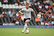 Fulham midfielder, Tom Cairney (10) dribbling during the Pre-Season Friendly match between Fulham and Crystal Palace at Craven Cottage, London, England on 30 July 2016. Photo by Matthew Redman.