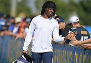 Aug 6, 2018; Costa Mesa, CA, USA: Los Angeles Chargers cornerback Channing Stribling (42) is greeted by fans during training camp at the Jack. R. Hammett Sports Complex.