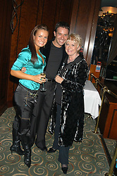 Left to right, dancer LILIA KOPYLOVA, dancer DARREN BENNETT and GLORIA HUNNIFORD at a party to celebrate the publication of 'Next To You' - Caron's Courage remembered by her mother Gloria Hunniford held on Caron's birthday at The Hilton Park Lane, London on 5th Octobe 2005.<br />