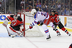 Jan 31; Newark, NJ, USA; New Jersey Devils goalie Martin Brodeur (30) makes a save on New York Rangers center Brian Boyle (22) during the first period at the Prudential Center.