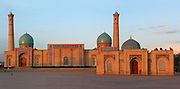 """Low angle view of Tellya Sheikh Mosque, founded 16th century, restored 19th century, Khast Imam Square, Tashkent, Uzbekistan, pictured on July 4, 2010, in the afternoon. Tashkent's main Friday mosque holds the Osman Koran, claimed to be the world's oldest, in its library. Tashkent, 2000 year old capital city of Uzbekistan, a Silk Road city whose name means """"Stone Fortress"""", is now very modern due to a disastrous earthquake in 1966, after which it was greatly rebuilt. However, some of the old buildings still stand in the glittering modern city. Picture by Manuel Cohen."""