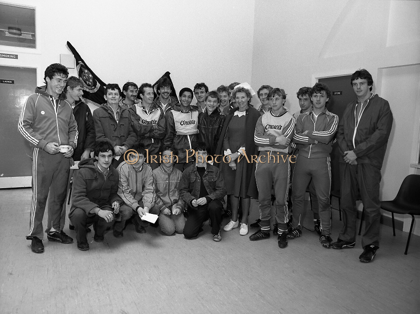 Ireland Soccer Team Training.1983.14.11.1983.11.14.1983.14th November 1983..The Ireland Soccer team trained, for the forthcoming match against Malta, at Stewarts Hospital,Palmerstown Dublin.Image of players,fans and a nursing sister from Stewarts Hospital as the line up for a group photograph.