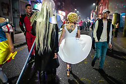 © Licensed to London News Pictures . 27/12/2018. Wigan, UK. Marilyn Monroe arrives on King Street . Revellers in Wigan enjoy Boxing Day drinks and clubbing in Wigan Wallgate . In recent years a tradition has been established in which people go out wearing fancy-dress costumes on Boxing Day night . Photo credit: Joel Goodman/LNP
