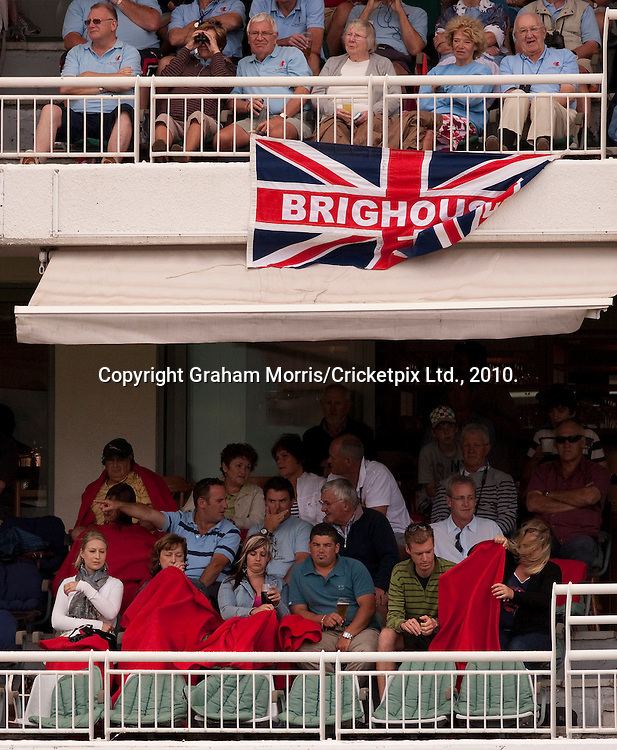 England supportters (above) in shirt sleeves as South Africans in their private box huddle under blankets during the third Test Match at Newlands, Cape Town. Photograph © Graham Morris/cricketpix.com (Tel: +44 (0)20 8969 4192; Email: sales@cricketpix.com)