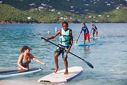 Javon Fleming, right, glides into chore and races for the finish line as volunteer Linda Wright, left, looks on.  Practicing for Paddle in the Park at Magen's Bay. St. Thomas, USVI.  24 October 2015. © Aisha-Zakiya Boyd