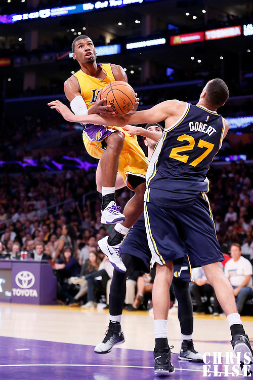 19 October 2014: Los Angeles Lakers guard Ronnie Price (9) is fouled by Utah Jazz center Rudy Gobert (27) during the Los Angeles Lakers 98-91 victory over the Utah Jazz, in a preseason game, at the Staples Center, Los Angeles, California, USA.