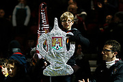 Northampton Town fan lifts tin foil FA Cup and swings scarf the The FA Cup match between Northampton Town and Derby County at the PTS Academy Stadium, Northampton, England on 24 January 2020.