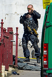 © Licensed to London News Pictures. 30/06/2015. London, UK. An armed police officer. Members of the emergency service take part in a mocked-up terrorist firearms attack at Aldwych station in central London. The exercise is the biggest to take place in London and is happening a week after dozens of people where killed when a gunman opened fire on a beach in Tunisia.  Photo credit: Ben Cawthra/LNP