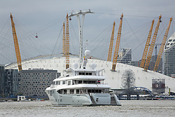 © Licensed to London News Pictures. 21/10/2013. The brand new superyacht ODESSA II arrived in London today. The 73-metre yacht went through the Thames Barrier shortly after 3pm and then headed to West India Docks. The owner of the yacht, which was built this year by Nobiskrug has not been made public. Credit : Rob Powell/LNP