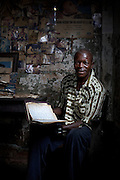 Banana record keeper Kakule, pictured an his home in Yangambi, DR Congo, on Monday, Dec. 8, 2008. Kakule was a former assistant to Edmond De Langhe in the 1970's. His notebook, which he continues to refer to, contains banana records at Yangambi dating from 1974 until 1992.