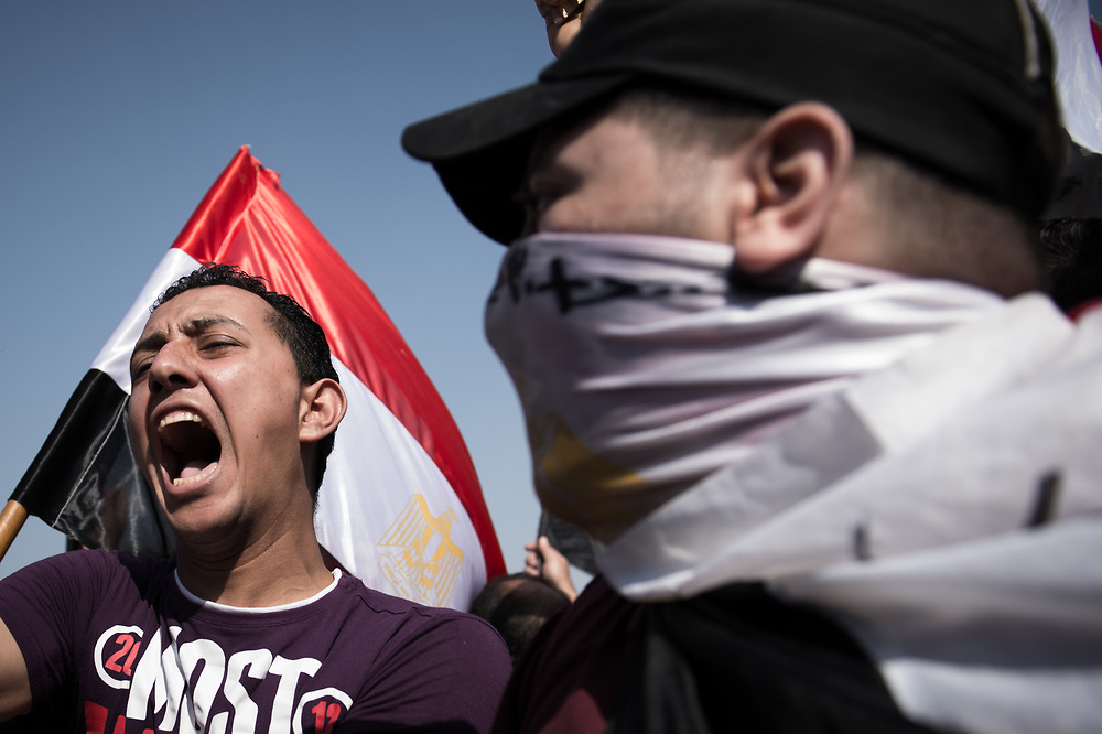 Opponents of President Morsi shout slogans and carry a Egyptian Flag during a rally in Tahrir Square in Cairo, Egypt, July 3, 2013
