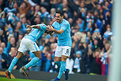 MANCHESTER, ENGLAND - Saturday, April 7, 2018: Manchester City's Ilkay Gundogan (right) celebrates scoring the second goal with team-mate Raheem Sterling during the FA Premier League match between Manchester City FC and Manchester United FC at the City of Manchester Stadium. (Pic by David Rawcliffe/Propaganda)