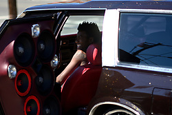 Tyquan Elliott, 17, sits back in the drivers seat as he listens the extreme loud music from the amplified stereo-system that shakes the bodywork of the car during a community car show in North Philadelphia, on Sunday September 15, 2019.