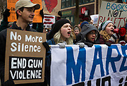Protestors chant and march down State Street during the March for our Lives protest in Madison, Wisconsin, Saturday, March 24, 2018.