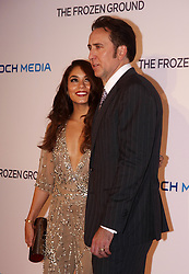 'The Frozen Ground' London Premiere.<br /> Actress Vanessa Hudgens with her costar Nicolas Cage at the Premiere of their latest film ''The Frozen Ground', in London's Leicester Square,<br /> London, United Kingdom<br /> Wednesday, 17th July 2013<br /> Picture by Max Nash / i-Images