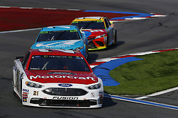 September 30, 2018 - Concord, North Carolina, United States of America - Paul Menard (21) races during the Bank of America ROVAL 400 at Charlotte Motor Speedway in Concord, North Carolina. (Credit Image: © Chris Owens Asp Inc/ASP via ZUMA Wire)