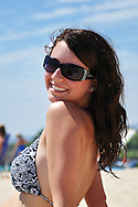 A beautiful smiling young woman at the beach