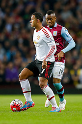 Memphis Depay of Manchester United is challenged by Jordan Ayew of Aston Villa - Mandatory byline: Rogan Thomson/JMP - 07966 386802 - 14/08/2015 - FOOTBALL - Villa Park Stadium - Birmingham, England - Aston Villa v Manchester United - Barclays Premier League.