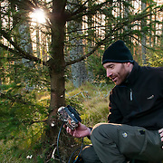 Roo Campbell setting camera trap for Scottish wildcat.