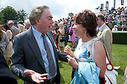 LORD ANDREW LLOYD WEBBER; KATHY LETTE, Glorious Goodwood. Ladies Day. 28 July 2011. <br /> <br />  , -DO NOT ARCHIVE-© Copyright Photograph by Dafydd Jones. 248 Clapham Rd. London SW9 0PZ. Tel 0207 820 0771. www.dafjones.com.