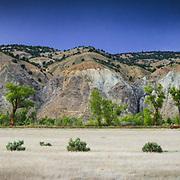 The dry grasslands and Gypsum hillsides in summer near Gypsum Colorado.