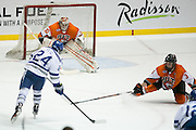 RIT goaltender Mike Rotolo prepares to make a save against Air Force forward A.J. Reid during the Atlantic Hockey semifinal at the Blue Cross Arena at the War Memorial in Rochester on Friday, March 18, 2016.