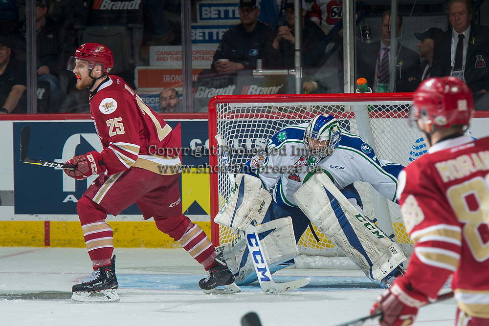 REGINA, SK - MAY 19: Stuart Skinner #74 of Swift Current Broncos looks for the puck behind Jeffrey Truchon-Viel #25 of Acadie-Bathurst Titan at the Brandt Centre on May 19, 2018 in Regina, Canada. (Photo by Marissa Baecker/CHL Images)