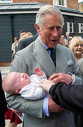 HRH The Prince of Wales visits Poundbury on the 20th Anniversary of the development. HRH The Prince of Wales with 14 week old Scarlett Coleman and her mother Amy Nash, Butter Market, Poundbury, Dorchester, Dorset, Friday 03 May, 2013, Photo by: i-Images