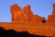 Sunrise light on sandstone formations near Park Avenue & Courthouse Towers, Arches National Park, UTAH