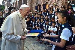 Pope Francis greets children before a meeting with the bishops of Myanmar on November 29,2017 in Yangon,Myanmar. Pope Francis' visit in Myanmar and Bangladesh runs from 27 November to 02 December 2017. Photo by ABACAPRESS.COM