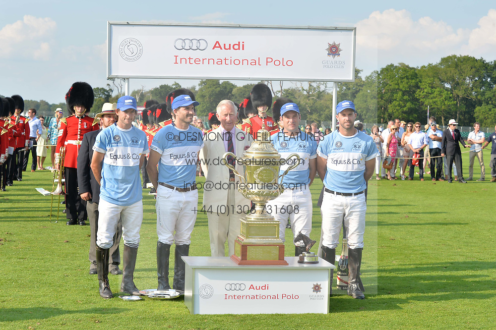 HRH The PRINCE OF WALES with The Argentine Polo team winners of the Coronation Cup (Adolfo Cambiaso, Facundo Pieres, Julio Ruggeri, Francisco Beláustegui)at the Audi International Polo at Guards Polo Club, Windsor Great Park, Egham, Surrey on 26th July 2014.