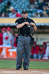 OAKLAND, CA - APRIL 29:  MLB umpire Scott Barry #87 stands on the field before the game between the Oakland Athletics and the Los Angeles Angels of Anaheim at O.co Coliseum on April 29, 2015 in Oakland, California. The Los Angeles Angels of Anaheim defeated the Oakland Athletics 6-3. (Photo by Jason O. Watson/Getty Images) *** Local Caption *** Scott Barry