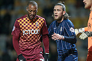 Wes Thomas (Bradford City) and Ben Coker (Southend United) during the Sky Bet League 1 match between Bradford City and Southend United at the Coral Windows Stadium, Bradford, England on 16 February 2016. Photo by Mark P Doherty.