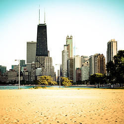 Chicago skyline at north avenue beach photo. Picture includes North Avenue Beach and the famous Hancock Center Building which is one of the most popular and tallest skyscrapers in the world. Photo was taken in 2012 and is high resolution.