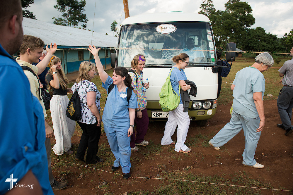 Dr. Katie Butler, a critical care surgeon from Boxford, Mass., attending Our Savior Lutheran Church in Topsfield, Mass., holds a makeshift fence up for fellow volunteers of the Mercy Medical Team as they leave for the hotel on Friday, June 13, 2014, at the Luanda Doho Primary School in Kakmega County, Kenya. LCMS Communications/Erik M. Lunsford