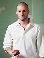 Cricket player holding ball portrait
