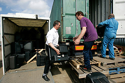 UK ENGLAND CORBY 26MAY05 - Günther Focke of Germany helps his friend Chris to load a container with second-hand TV sets destined for export to Uganda. Mr Focke, a private investigator by trade, claims to be the son of Prince Philip, husband to Queen Elizabeth II. He has summarised his story in a soon-to-be published book, 'Tommie'...jre/Photo by Jiri Rezac..© Jiri Rezac 2004..Contact: +44 (0) 7050 110 417.Mobile:  +44 (0) 7801 337 683.Office:  +44 (0) 20 8968 9635..Email:   jiri@jirirezac.com.Web:     www.jirirezac.com..© All images Jiri Rezac 2004 - All rights reserved..