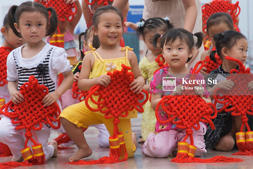 Children performing in the square, Wushan, China
