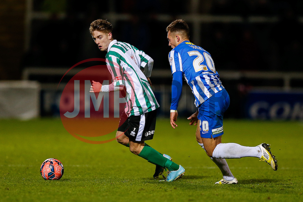 Jarrett Rivers of Blyth Spartans is challenged by Dan Jones of Hartlepool United - Photo mandatory by-line: Rogan Thomson/JMP - 07966 386802 - 05/12/2014 - SPORT - FOOTBALL - Hartlepool, England - Victoria Park - Hartlepool United v Blyth Spartans - FA Cup Second Round Proper.