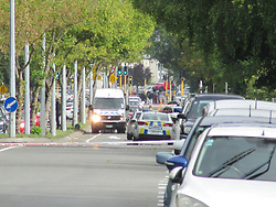 March 15, 2019 - Christchurch, New Zealand - 15 March 2019. At least 27 have been killed, 30 wounded in shooting in two mosques in Christchurch, New Zealand. In photo: Armed police cordon near one of the mosques, located on Deans Ave. (Credit Image: © Russian Look via ZUMA Wire)